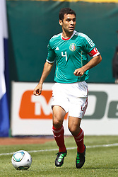 March 26, 2011; Oakland, CA, USA;  Mexico defender Rafael Marquez (4) dribbles the ball up field against Paraguay during the first half at Oakland-Alameda County Coliseum. Mexico defeated Paraguay 3-1.