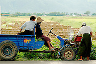 Farmers repairing a tractor near the rice fields of Nyaungshwe