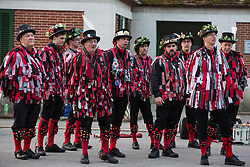 Runnymede, UK. 1st May, 2019. Datchet Border Morris sing a folk song after providing a display of traditional morris dancing at sunrise on May Day. An all male Border Morris side with a mixed band, Datchet Border Morris have been dancing on the same site on May Day for 25 years.