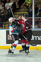 KELOWNA, CANADA - JANUARY 26: Linesman Tim Plamondon gets between Bowen Byram #44 of the Vancouver Giants and Michael Farren #16 of the Kelowna Rockets during first period  on January 26, 2019 at Prospera Place in Kelowna, British Columbia, Canada.  (Photo by Marissa Baecker/Shoot the Breeze)