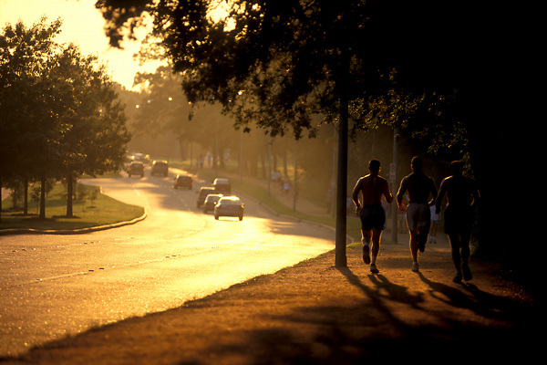 Stock photo of men jogging along the trail at Memorial Park.