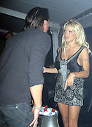"""*EXCLUSIVE**.Pamela Anderson is furious because her ex-boyfriend Marcus Schenkenberg is telling her that her ex-husband, Kid Rock and May Anderson are also at VIP Room. She is saying to Marcus """" He is here?"""" while pointing down..VIP Room Nightclub - 2007 Cannes Film Festival .Cannes, France .Thrusday, May 17, 2007.Photo By Celebrityvibe; .To license this image please call (212) 410 5354 ; or.Email: celebrityvibe@gmail.com ;"""
