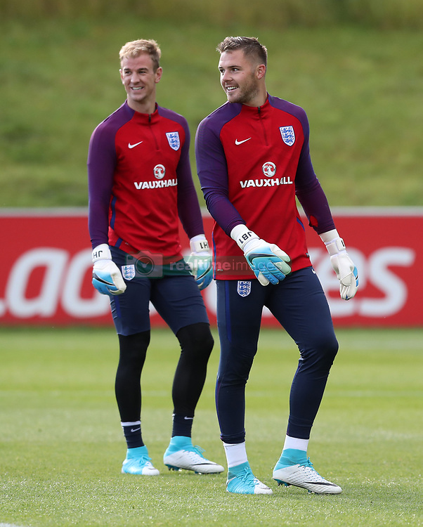 England's Joe Hart and Jack Butland during the training session at St George's Park, Burton.