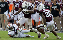 Texas A&M defensive back Armani Watts (23) reacts after tackling Auburn wide receiver Ryan Davis (23) during the fourth quarter of an NCAA college football game on Saturday, Nov. 4, 2017, in College Station, Texas. (AP Photo/Sam Craft)