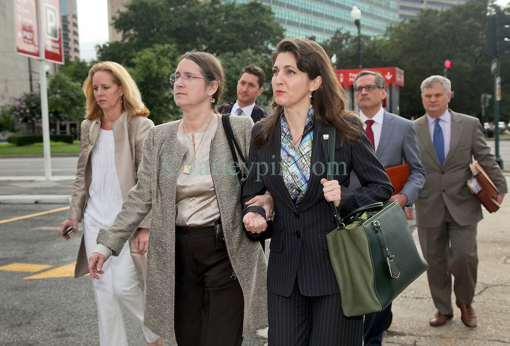 01 June  2015. New Orleans, Louisiana. <br /> Rita Benson LeBlanc (rt)) and her mother Renee (center) leave New Orleans Civil District Court surrounded by lawyers following a hearing to determine the competency of grandfather/father Tom Benson. Benson is the billionaire owner of the NFL New Orleans Saints, the NBA New Orleans Pelicans, various Mercedes dealerships, banks, property assets and a slew of business interests. Rita, her brother and mother demanded a competency hearing after Benson changed his succession plans and decided to leave the bulk of his estate to third wife Gayle, sparking a controversial fight over control of the Benson business empire.<br /> Photo&copy;; Charlie Varley/varleypix.com
