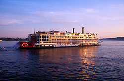 On the Mississippi River, between Vicksburg and Natchez:  The Mississippi Queen paddlewheeler glows at sunset.