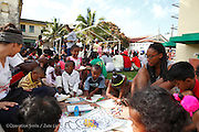 Children playing with child life during screening on day one. Tamatave Hospital. Operations Smile's 2014 mission to Tamatave Madagascar. 10th - 20th September 2014<br /> <br /> (Operation Smile Photo - Zute Lightfoot)