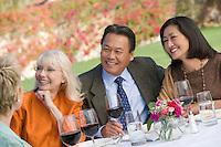 Friends drinking wine in garden