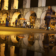 Night life around the Lapa Aquaduct, Rio de Janeiro, a popular location on Friday and Saturday night and a cheaper alternative for revellers heading too and from the main bar and restaurant area in the Lapa district. Rio de Janeiro,  Brazil. 18th September 2010. Photo Tim Clayton