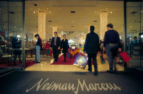 Stock photo of shoppers going in and out of the Neiman Marcus store in the Galleria mall in Houston Texas