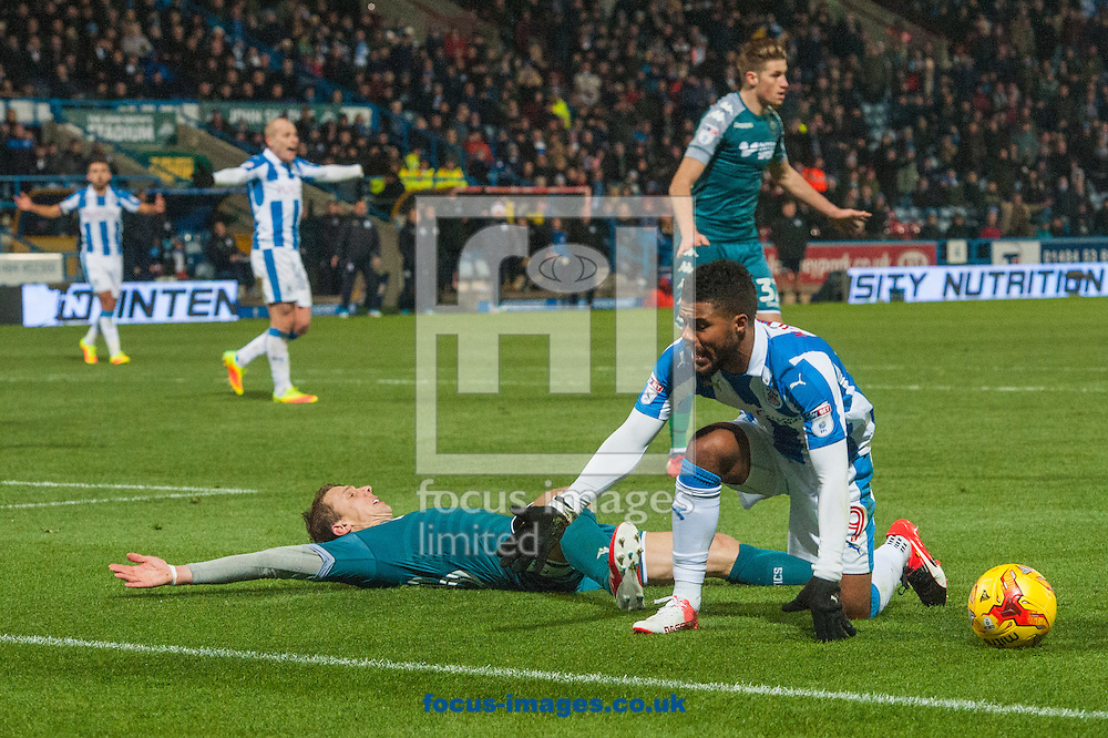Elias Kachunga of Huddersfield Town complains after going down under a challenge from Stephen Warnock of Wigan Athletic during the Sky Bet Championship match at the John Smiths Stadium, Huddersfield<br /> Picture by Matt Wilkinson/Focus Images Ltd 07814 960751<br /> 28/11/2016