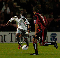 Photo: Leigh Quinnell.<br /> AFC Bournemouth v Bristol City. Coca Cola League 1. 26/09/2006. Bristols Jennison Myrie-Williams finds his way through the Bournemouth defence.