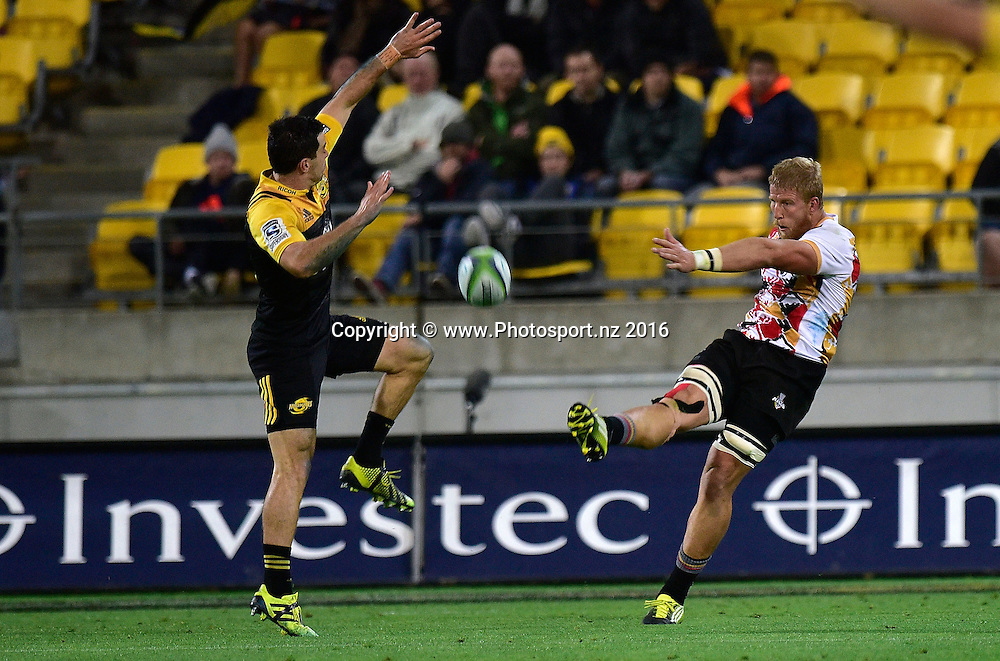 Jacques Engelbrecht (R of the Southern Kings kicks the ball past James Marshall of the Hurricanes during the Hurricanes vs Kings Super Rugby  match at the Westpac Stadium in Wellington on Friday the 25th of March 2016. Copyright Photo by Marty Melville / www.Photosport.nz