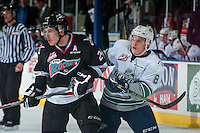 KELOWNA, CANADA - NOVEMBER 25: Scott Eansor #8 of Seattle Thunderbirds stick checks Tyson Baillie #24 of Kelowna Rockets on November 25, 2015 at Prospera Place in Kelowna, British Columbia, Canada.  (Photo by Marissa Baecker/Getty Images)  *** Local Caption *** Tyson Baillie; Scott Eansor;