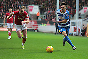 Bristol City defender Luke Ayling chases Queens Park Rangers defender Grant Hall during the Sky Bet Championship match between Bristol City and Queens Park Rangers at Ashton Gate, Bristol, England on 19 December 2015. Photo by Jemma Phillips.
