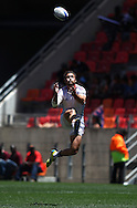 Vincent Deniau of France gets up high for the high ball during the match between France and Scotland of the HSBC Sevens World Series Port Elizabeth Leg held at the Nelson Mandela Bay Stadium on 7th December 2013 in Port Elizabeth, South Africa. Photo by Shaun Roy