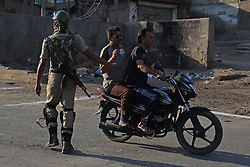 May 29, 2017 - Srinagar, Jammu and Kashmir, India - Indian paramilitary troopers  inspects the commuters during a curfew in downtown Srinagar. Authorities imposed curfew in Srinagar as violence spread across the valley  (Credit Image: © Umer Asif/Pacific Press via ZUMA Wire)
