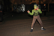 Oct. 25, 2013 - Bronx, NY. The Frankenstein monster strikes a karate pose at the 28th Annual South Bronx Halloween Parade in Hunts Point. 10/25/2013 Photo by Nicholas Wells / CUNY Photo Wire