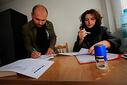 ROMANIA ONESTI 26OCT12 - Liviu Cioineag, manager of the Zarnesti Bear Sanctuary (L) and Diana, the administrator at Onesti zoo sign transfer papers for the rescued bears. The zoo  has been shut down due to non-adherence with EU regulations on the welfare of animals.....jre/Photo by Jiri Rezac / WSPA....© Jiri Rezac 2012