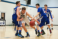 during the first round of the boys high school basketball playoffs between the Colchester Lakers and the Mount Mansfield Cougars at MMU High School on Tuesday night February 16, 2016 in Jericho. (BRIAN JENKINS/for the FREE PRESS)