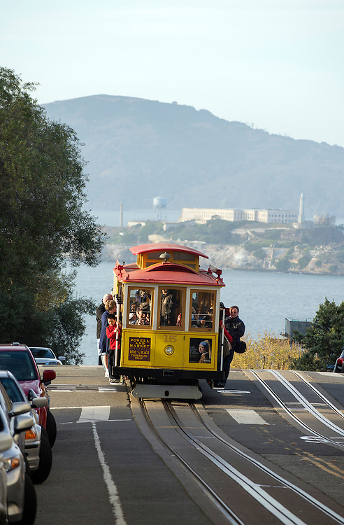 Cablecar on Russian Hill with Alcatraz Island in the background, San Francisco, California