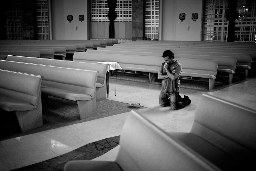 "Greg Musumano prays at St. Agnes Catholic Church in North Naples on April 5, 2011. ""If this life is everything for you, when you lose a child then where do you go from there? Your sense of devastation will be that much more. So even if it is devastating, I realize that our life doesn't end here and I'll be with him again,"" Musumano said."