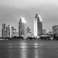 San Diego skyline at night black and white photo with downtown city buildings along San Diego Bay.