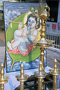 a wall painting of young lord krishna with a flute. India, Kerala, a state on the tropical coast of south west India