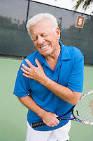 Tennis player suffering from shoulder injury