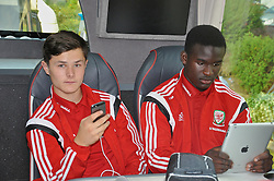 NEWPORT, WALES - Tuesday, September 23, 2014: Wales' Liam Cullen and Ibi Sosani on the team bus before the Under-16's International Friendly match against France at Dragon Park. (Pic by Cledwyn Ashford/Propaganda)