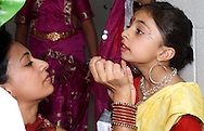 Neetu Verma of Cincinnati gets daughter Siya, 6 ready to perform in the India Club of Greater Dayton's Diwali 2011 at Northmont High School in Clayton, Saturday, November 12, 2011..