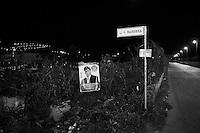 Torretta, Italy, 17 October 2012: An unauthorized election banner of candidate Massimo Gargano of UdC (Unione di Centro) is hanged on a wire netting next to the plate of a street dedicated to the Sicilian dialectal poet Ignazio Buttitta, in Torretta, Italy, on 17 October 2012.<br /> <br /> The direct elections in Sicily for the President of the Region and its representatives will take place on Sunday 28 October 2012, 6 months ahead of the end of the terms of office of the current legislature. The anticipated election of October 28 take place after Raffaele Lombardo, former governor of Sicily since 2008, resigned on July 31st. Raffaele Lombardo is under investigation since 2010 for Mafia ties. His son Toti Lombardo is currently running for a seat in the Sicilian Regional Assembly in the coalition of Gianfranco Micciché, a candidate for the Presidency of the Region. 32 candidates belonging to 8 of the 20 parties running for the Sicilian elections are either under investigation or condemned. ### Torretta, Italia, 17 ottobre 2012: Un manifesto elettorale abusivo di Massimo Gargano dell'UdC è appeso ad una rete di ferro accanto alla targa di una via dedicata al poeta  siciliano Ignazio Buttitta, a Torretta, Italia, il 17 ottobre 2012.<br /> <br /> Le elezioni in Sicilia per la votazione diretta del presidente della regionee dei deputati all'Assemblea regionale (ARS)si terranno domenica 28 ottobre, in anticipo sulla scadenza naturale dell'attuale legislatura, prevista ad aprile dell'anno prossimo. In Sicilia si vota in anticipo dopo le dimissionidel 31 luglio scorso di Raffaele Lombardo, eletto presidente della regione nell'aprile del 2008 e indagato dal 2010 per concorso esterno in associazione mafiosa. 32 candidati appartenenti a 8 delle 20 liste candidate alle elezioni siciliani sono indagati o condannati.