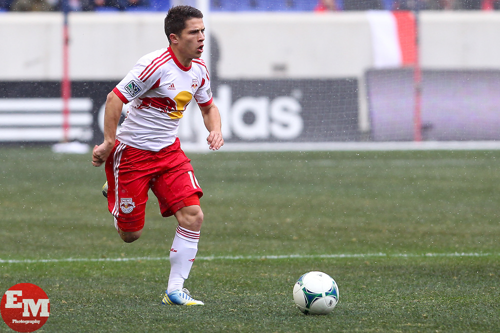 Mar 16, 2013; Harrison, NJ, USA; New York Red Bulls defender Connor Lade (16) dribbles the ball during the second half at Red Bull Arena. The match ended in a 0-0 tie.
