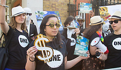 """St James, London, May 12th 2016. Protesters from transparency and accountability group One demonstrate demanding """"a new, global standard of transparency that could end the corruption that keeps people poor""""."""