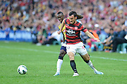 21.04.2013 Sydney, Australia. Mark Bridge and Bernie Ibini-Isei in action during the Hyundai A League grand final game between Western Sydney Wanderers FC and Central Coast Mariners FC from the Allianz Stadium.Central Coast Mariners won 2-0.