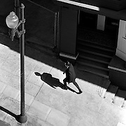 Man striding uphill on steep San Francisco street