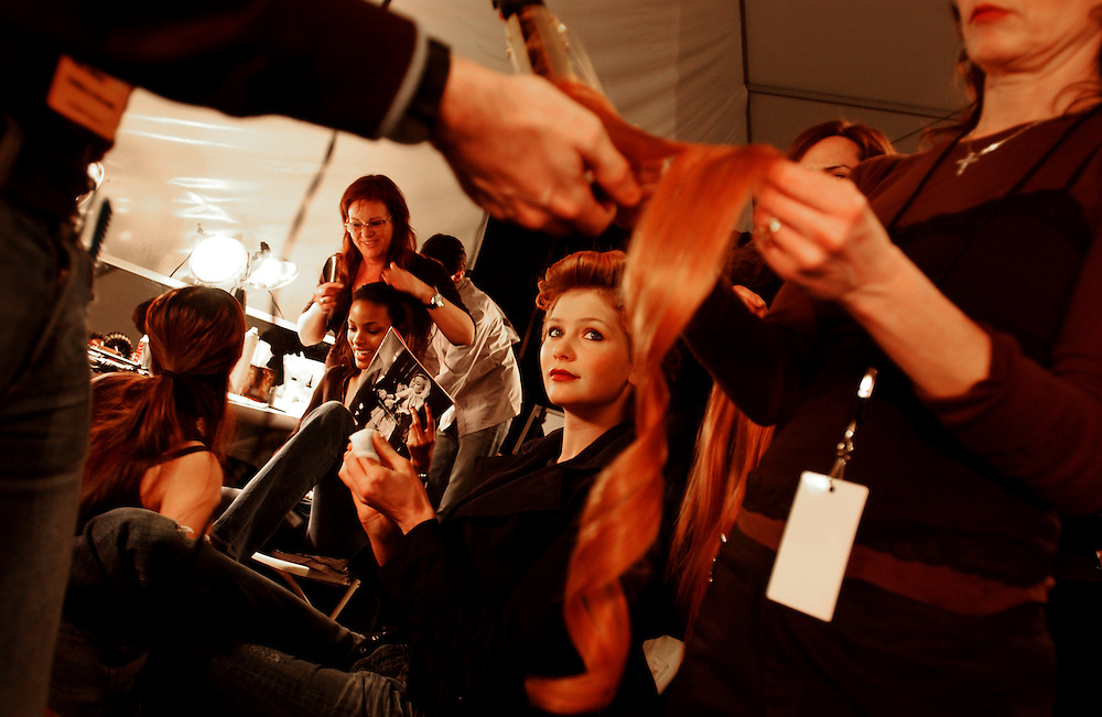 A model prepares backstage at the Pamella Roland runway show, part of New York Fashion Week.