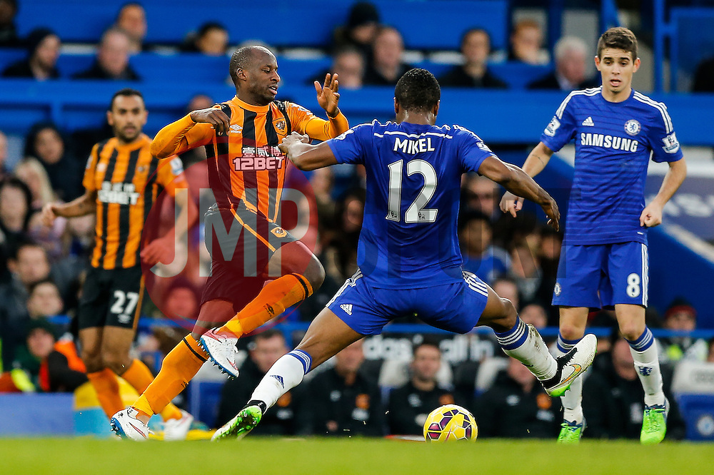 Sone Aluko of Hull City is challenged by Mikel John Obi of Chelsea - Photo mandatory by-line: Rogan Thomson/JMP - 07966 386802 - 13/12/2014 - SPORT - FOOTBALL - London, England - Stamford Bridge - Chelsea v Hull City - Barclays Premier League.