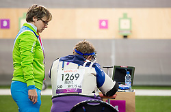 Damjan Pavlin of Slovenia and coach Polonca Sladic (L) during the Men's R5-10m Air Rifle Prone shooting Final during Day 4 of the Summer Paralympic Games London 2012 on September 1, 2012, in Royal Artillery Barracks, London, Great Britain. (Photo by Vid Ponikvar / Sportida.com)