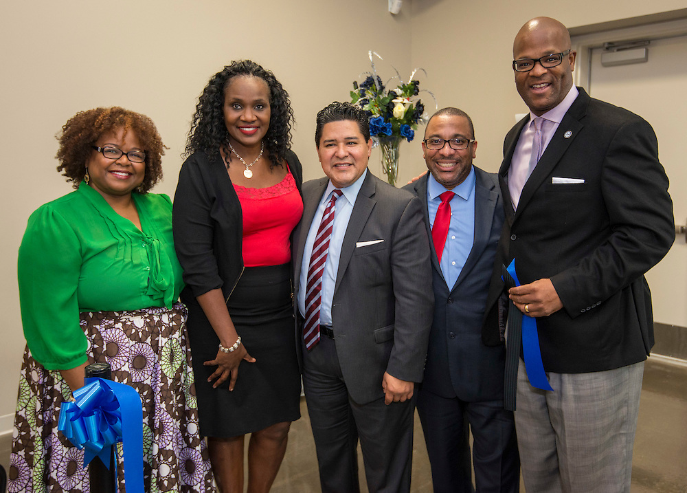 Samantha Brooks, Houston ISD trustee Wanda Adams, superintendent Richard Carranza, Steve Gourrier and Dwight Boykins pose for a photograph following a ribbon cutting ceremony at South Early College High School, October 8, 2016.