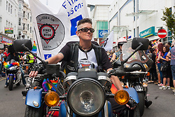 """Brighton, August 2nd 2014. """"Dykes on Bikes"""", a women's motorcycle club take part in the Brighton Pride procession."""