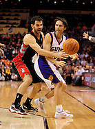Jan. 24, 2012; Phoenix, AZ, USA; Phoenix Suns guard Steve Nash (13) is guarded by Toronto Raptors guard Jose Calderon (8) during the second half at the US Airways Center. The Raptors defeated the Suns 99-96. Mandatory Credit: Jennifer Stewart-US PRESSWIRE..