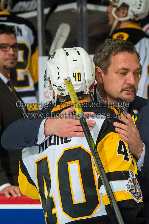 REGINA, SK - MAY 25: Ryan Moore #40 of Hamilton Bulldogs is hugged by head coach John Gruden after the loss to the Regina Pats at the Brandt Centre on May 25, 2018 in Regina, Canada. (Photo by Marissa Baecker/CHL Images)