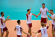 (C) Michal Winiarski and (R) Bartosz Kurek with their team mates celebrate winning point during the 2013 CEV VELUX Volleyball European Championship match between Poland and Turkey at Ergo Arena in Gdansk on September 20, 2013.<br /> <br /> Poland, Gdansk, September 20, 2013<br /> <br /> Picture also available in RAW (NEF) or TIFF format on special request.<br /> <br /> For editorial use only. Any commercial or promotional use requires permission.<br /> <br /> Mandatory credit:<br /> Photo by &copy; Adam Nurkiewicz / Mediasport