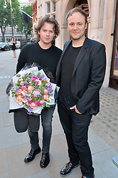 Left to right, CHRISTOPHER KANE and NICHOLAS KIRKWOOD at the opening of Roksanda - the new Mayfair Store for designer Roksanda Ilincic at 9 Mount Street, London on 10th June 2014.