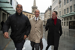 © Licensed to London News Pictures. 21/01/2018. London, UK. UKIP party leader HENRY BOLTON (centre) is seen arriving at Broadcasting House in London flanked by security and a reporter, ahead of radio and television appearances. The Uk Independence Part NEC is due to meet today to discuss Henry Bolton's leadership following a number of unfavourable stories about Bolton's private life.  Photo credit: Ben Cawthra/LNP