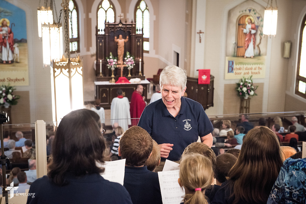 Deaconess Lynnette Fredericksen leads the children's choir during the beginning of a Divine Service of Rededication at St. Paul Lutheran Church in Hamel, Ill., on Sunday, Sept. 7, 2014. LCMS Communications/Erik M. Lunsford