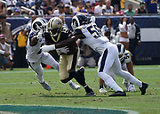 New Orleans Saints wide receiver Michael Thomas (13) runs with the ball while Los Angeles Rams inside linebacker Cory Littleton (58) defends during an NFL football game, Sunday, Sept. 15, 2019, in Los Angeles. The Rams defeated the Saints 27-9. (Dylan Stewart/Image of Sport)