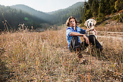 "Tyler Hamilton, former member of US Postal Service Cycling Team. Photographed with his dog ""Tanker"" near Missoula, Montana by Brian Smale for the Sunday Times."