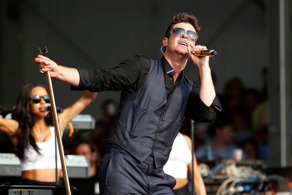 Working Up A Sweat<br /> <br /> Robin Thicke headlines on the Congo Square Stage at the 2014 New Orleans Jazz and Heritage Festival held on New Orleans Fair Grounds Race Track in New Orleans, Louisiana on Saturday, April 26, 2014. The singer started his set in a three piece suit, removing his vest by the end and being drenched in sweat.